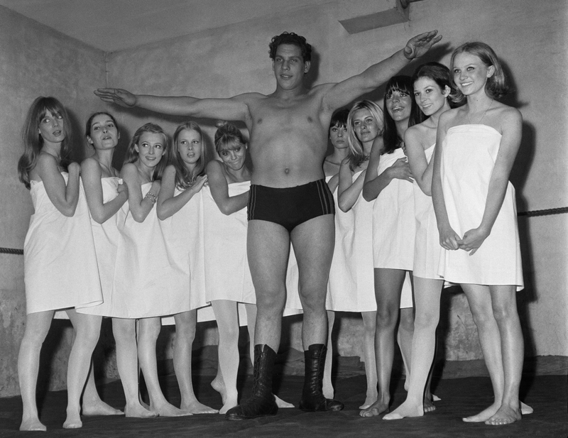 Andre the Giant, 19 years old, surrounded by 10 lovely girls in Towels. Paris, 1966.
