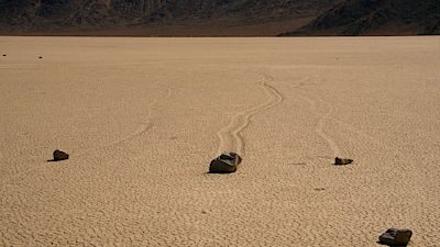 Sailing Rocks at Racetrack Playa, Death Vally National Park. Sailing Rocks leave trails on the Racetrack.