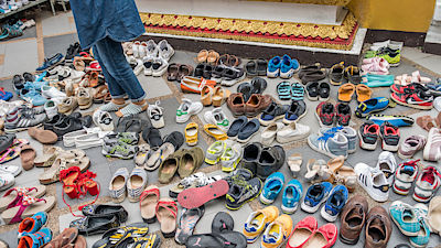 The tourist shoes at the temple. This picture is taken on 5 October 2016 at Doi Suthep (name) temple in Chiang Mai province , Thailand