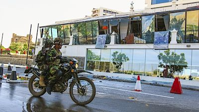 Sri Lankan soldiers pass the Kingsbury Hotel, which was the target of the assassination.