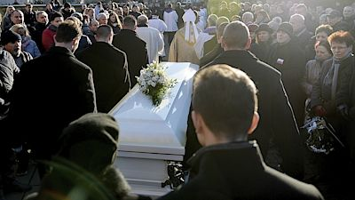People gather in front of the church after a funeral mass for the Polish truck driver Lukasz Urban, who was killed in the Berlin Christmas market attack, in the church in Banie, Poland, Friday, Dec. 30, 2016. (AP Photo/Lukasz Szelemej)