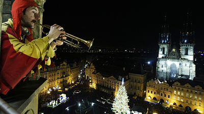 Trumpeter in the tower at the Old Town Hall Square