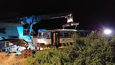 The crushed train was removed from the city, and a special crane returned it to the track after three in the morning (in the picture).